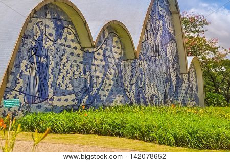 BH BRAZIL - DECEMBER 23 - An exterior view detail of the church of Sao Francisco de Assis on December 23 2015 in Belo Horizonte Brazil. Designed by Oscar Niemeyer is known as the Pampulha Church.