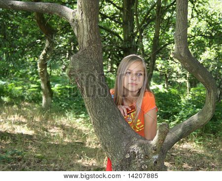 girl stood by tree