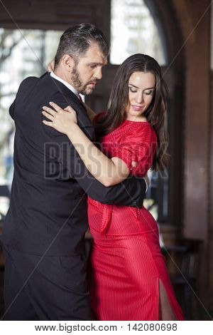 Man And Woman Performing Tango In Restaurant