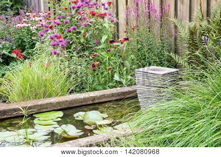 Beautiful ornamental garden with pond and little fountain