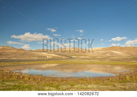 Colourful ground and lake with hot water -Myvatn area Iceland.