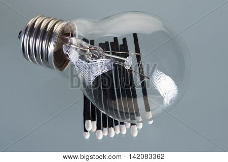 incandescent lamp, one  lamp on black matches