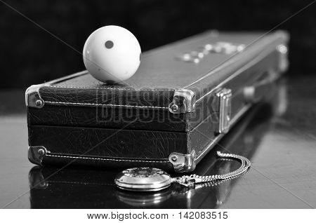 Pool cue ball on the vintage styled cue case.