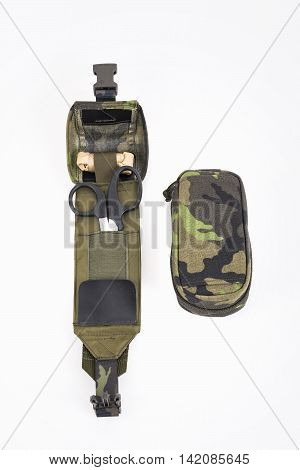 Travel first aid kit in camouflage housing for tourists and army.