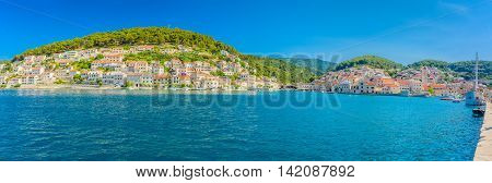 Waterfront summer panorama at town Pucisca, picturesque place on Adriatic sea, Island of Brac, Croatia.