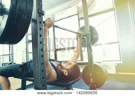 Fitness man workout with barbell in gym