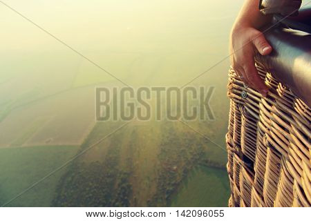 View from the balloon's basket. Amazing view from the height of the balloon. Summer beautiful fields landscape from the bird's eye, sunrise. Ballooning.