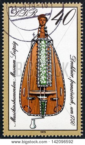 GERMANY - CIRCA 1979: a stamp printed in Germany shows French Barrel Lyre 18th Century Musical Instrument from Leipzig Museum circa 1979