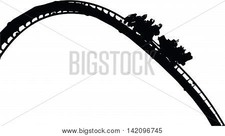 A silhouette of a rollercoaster ride ascending the hill.