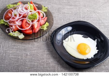 Homemade Breakfast Of Fried Egg And A Tomato Salad