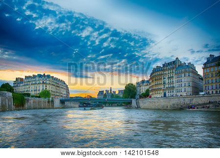 Beautiful View at sunset from a boat on Seine river iin Paris summer evening. FRANCE