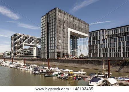 COLOGNE GERMANY - AUG 7 2016: Contemporary Crane Houses at the Rheinauhafen marina in the city of Cologne Germany