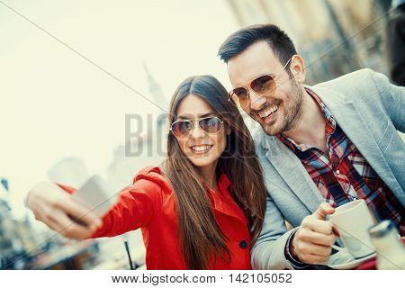 Young couple taking a selfie.They are enjoying together and having a great time.