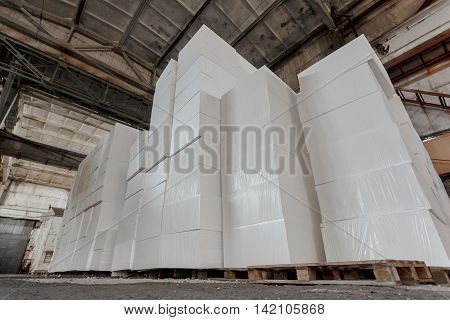 Polystyrene insulation boards. Polystyrene plates warehouse. Polystyrene Stack