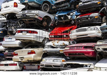 Indianapolis - Circa August 2016 - A Pile of Stacked Junk Cars - Discarded Junk Cars Piled Up V