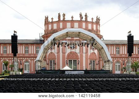 WIESBADEN, GERMANY - JULY 14: An established concert venue with rows of seats for a classical concert at the grounds of the castle Biebrich on July 14, 2016 in Wiesbaden.