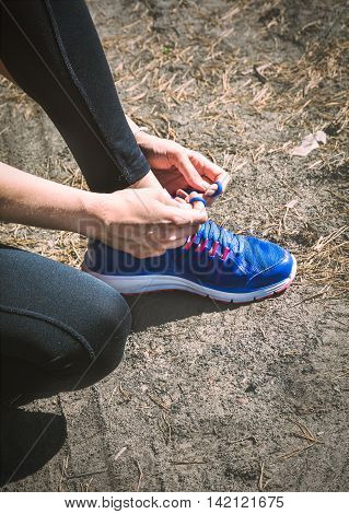 Running Shoes. Closeup Of Woman Tying Shoe Laces. Female Sport Fitness Runner Getting Ready For Jogg