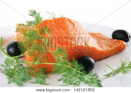 single pink salmon bit on a big white dish