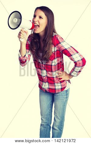 Isolated woman yelling into megaphone