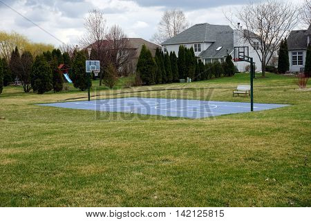 A basketball court in the back yard of a home in Joliet, Illinois.