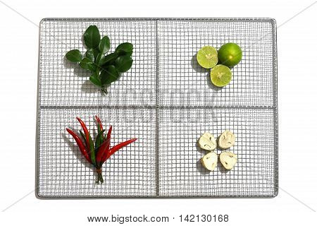 Fresh herbs and spices in a stainless plate on white background Ingredients of Thai spicy food Tom Yum Still life photography with ingredients The art of food