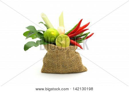 Fresh herbs and spices in a sack on white background Ingredients of Thai spicy food Ingredients of Tom yum Still life photography with ingredients The art of food photography with the ingredients
