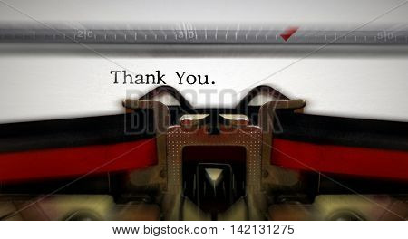 Old typewriter writting thank you text with blur motion