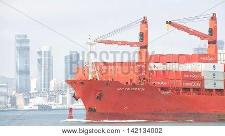 Oakland CA - August 08 2016: Cargo Ship CAP PALMERSTON traveling through the San Francisco Bay en route to the Port of Oakland city of San Francisco in the background.