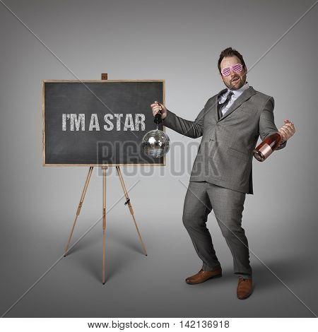 Im a star text on  blackboard with drunk businessman