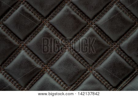 Diamond stitched leather furniture seamless pattern for background or texture.