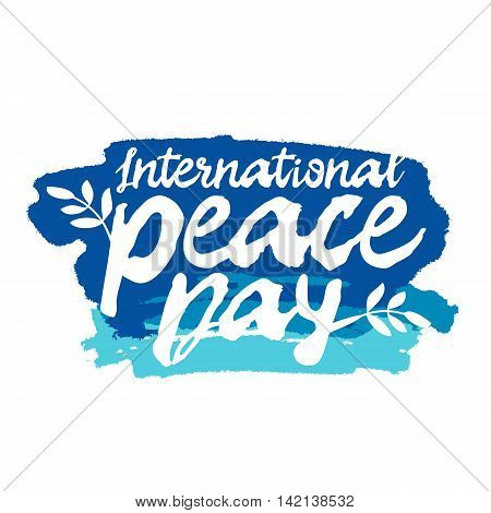 International Day of Peace. The trend calligraphy. Vector illustration on white background with a smear of ink blue. Excellent gift holiday card.