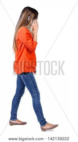 side view of a woman walking with a mobile phone. back view of girl in motion.  backside view of person.  Rear view people collection. Isolated over white background.  girl in a red jacket is talking