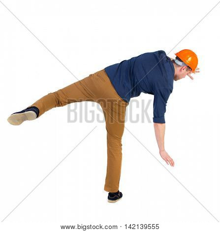Balancing young man.  or dodge the falling man. worker in construction helmet falls. Rear view people collection.  backside view of person.  Isolated over white background. a man in a blue shirt and a