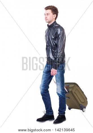 front  view of walking  man  with suitcase.  brunette guy in motion. backside view of person.  Rear view people collection. Isolated over white background. young man goes to side of a rolling travel