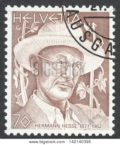 MOSCOW RUSSIA - CIRCA APRIL 2016: a post stamp printed in SWITZERLAND shows a portrait of Hermann Hesse the series