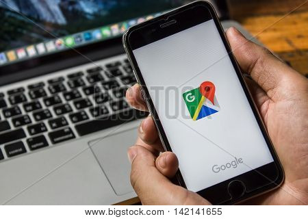 CHIANG MAI THAILAND - Jun 3 2016: Man hand holding Iphone 6s or 6Plus with Google Maps application o. Google Maps is a service that provides information about geographical regions and sites around the world.