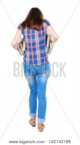 Girl comes with  stack of books. back side view. Rear view people collection.  backside view of person.  Isolated over white background. Girl in plaid shirt holding out underarm textbooks.
