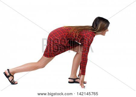side view woman start position.  Rear view people collection.  backside view of person.  Isolated over white background. The girl in red plaid dress standing sideways in the starting position the