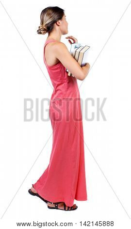 Girl comes with  stack of books. side view. Rear view people collection.  backside view of person.  Isolated over white background. A slender woman in a long red dress looking to the side while
