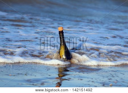 Glass Bottle On The Beach With A Secret Message