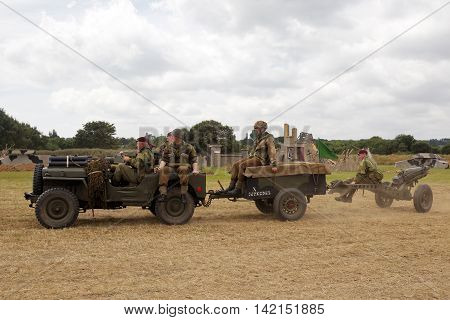WESTERNHANGER, UK - JULY 21: A demonstration on how to fire the midday gun gets underway in the arena for the public to watch at the War & Peace Revival show on July 21, 2016 in Westernhanger