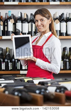 Saleswoman Showing Blank Tablet Computer In Winery