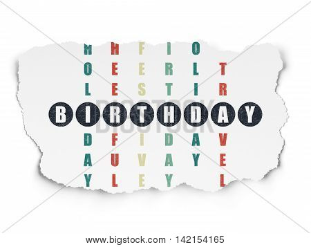 Holiday concept: Painted black word Birthday in solving Crossword Puzzle on Torn Paper background