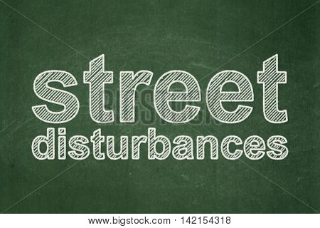Politics concept: text Street Disturbances on Green chalkboard background