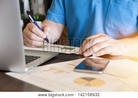 financial worker analyzing business data and working with laptop computer