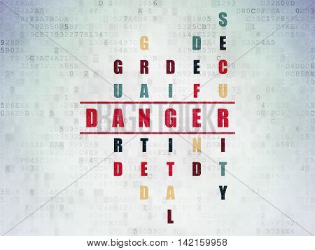 Safety concept: Painted red word Danger in solving Crossword Puzzle on Digital Data Paper background