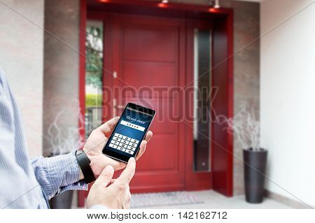 Man uses smartphone to open the door of his house