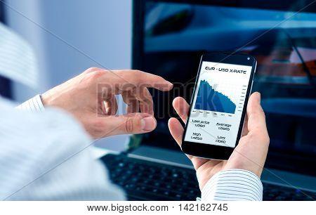 Businessman checks exchange rate on smartphone application