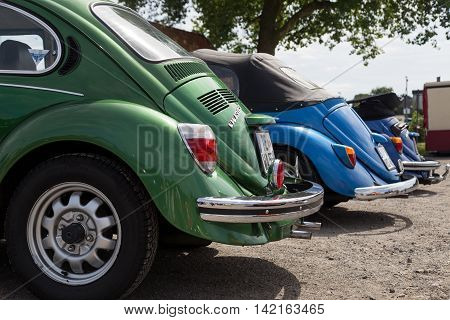 Celle, Germany - August 7, 2016: Detail view of three Volkswagen Kaefer at the annual Kaefer Meeting