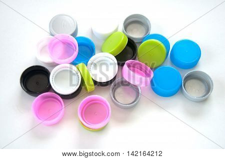 Plastic bottle screw caps isolated on white